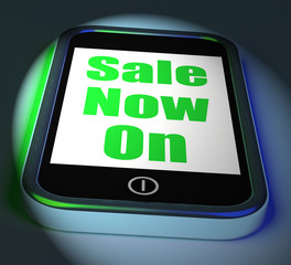 Sale Now On Phone Displays Promotional Savings Or Discounts