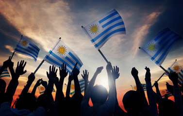Silhouettes of People Holding Flag of Uruguay