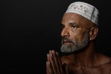 Indian Man Saying Prayers