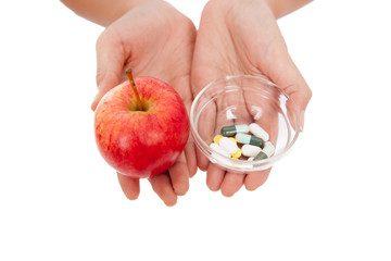 Hand hold medicine and apple