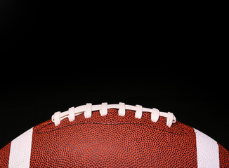 American Football. Ball over black background