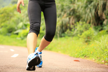 woman runner fall off by sports injury