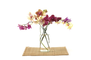 Blooming branch in vase on mat