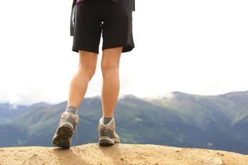 young woman hiker legs mountain peak