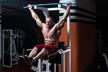 Young Man Doing Exercise For Abs
