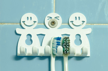 old wall hanger hook with toothbrush