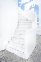 white spiral staircase and arch window