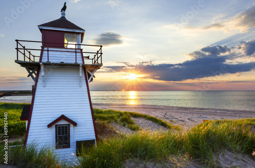 Fotobehang Vuurtoren / Mill Sunset at Covehead Harbour Lighthouse, PEI