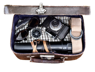 outdoor retro suitcase with things the traveler