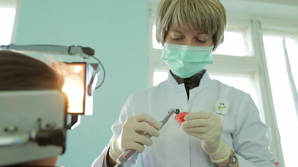 Orthodontist Filing Braces For Crooked Teeth With Special
