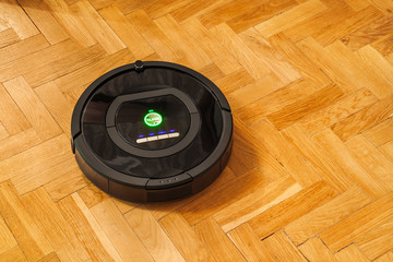 Robotic vacuum cleaner on parquet