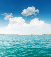 white clouds and turquoise sea