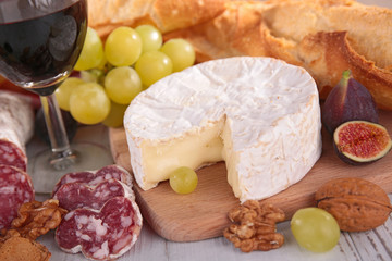 cheese with grape, sausage and wine