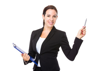 Businesswoman with clipboard and pen point up