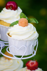 Cupcake with a yellow raspberry