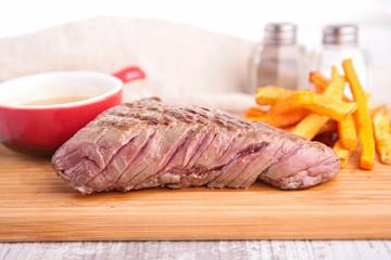 grilled steak on board