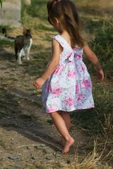 girl in a beautiful summer dress barefoot