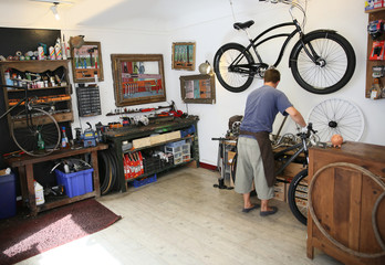 View of man working in bike shop