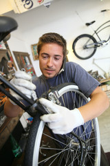 Man working in bike workshop