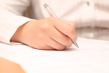 Businesswoman viewing the contract before signing