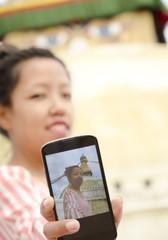 Woman taking her own selfie