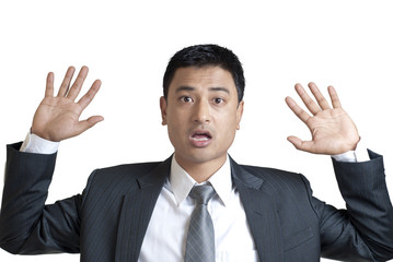 Young man with hands up