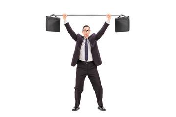 Joyful businessman lifting two briefcases on a bar