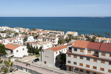 Views of Santa Pola town with Tabarca islet at the background