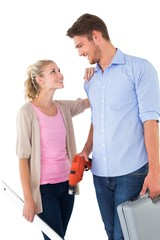 Attractive young couple holding diy tools