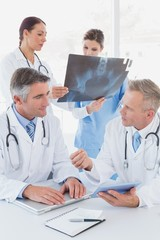 Doctor holding up an x-ray