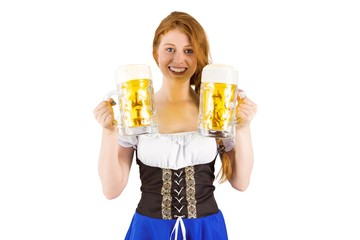 Oktoberfest girl holding jugs of beer