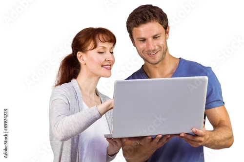 canvas print picture Couple using a laptop together