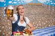 canvas print picture - Hübsche Frau im Bierzelt mit Bayrischen Spezialitäten