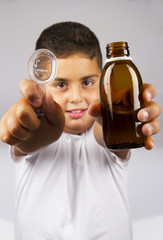 Child With Syrup Bottle