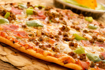 pizza with ground beef, ham, onion and green pepper