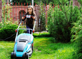 Kid girl with lawn mower