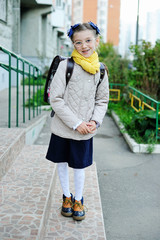 Beauty kid girl on her way to school