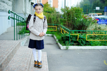 Beauty kid girl on her way to school