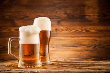 Glasses of beer on wooden planks