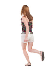 back view of running  woman in shorts