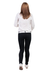back view of running  woman in jeans