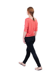 back view of walking  woman in jeans. beautiful blonde girl in m