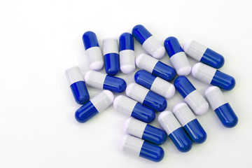 Close up of blue medical capsules isolated