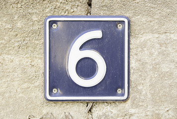 Number six on a wall of a house