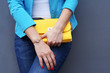 The fashionable young woman  holding yellow clutch - 69978422
