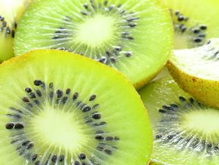 Whole kiwi fruit and his sliced segments isolated on white backg