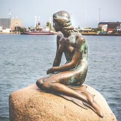 The Little Mermaid is a bronze statue in Copenhagen,Denmark