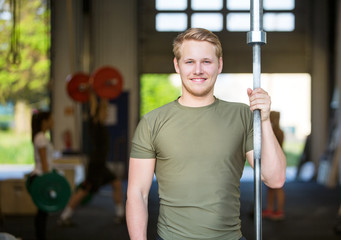 Athlete Holding Weightlifting Bar At Gym