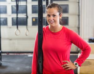 Confident Female Athlete in Cross Training Box