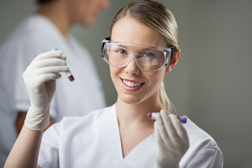 Technician Analyzing Blood Samples In Lab